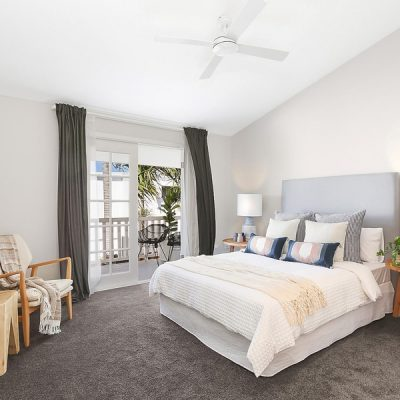 Pitched ceiling in master bedroom with french doors