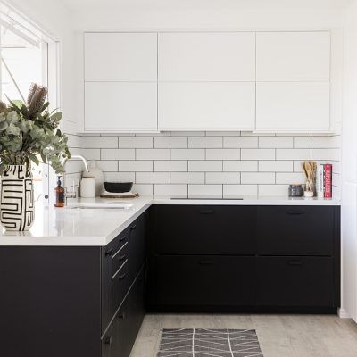 Matt black kitchen cabinet with subway brick pattern tile splashback