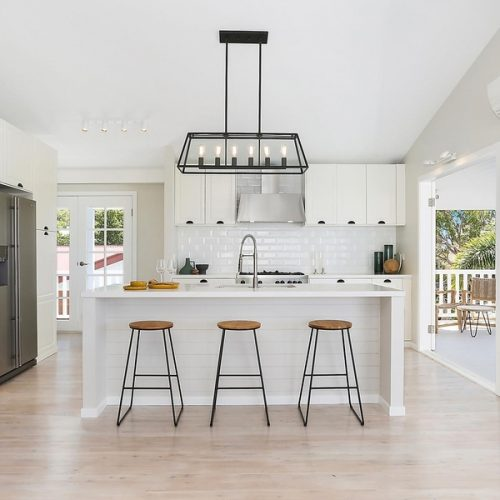 monochrome ultimate coast Hamptons kitchen with stone island bench and wrap around verandah